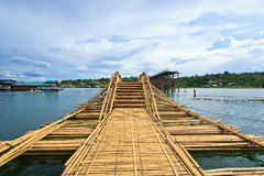 Utamanusorn bridge or Morn bridge, Thailand. It is the longest bamboo bridge in Thailand and the second one in the world. It is across Songkhalia river in Royalty Free Stock Image