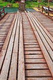 Utamanusorn bridge or Morn bridge was destroyed by natural diaster, Thailand. It is the longest bamboo bridge in Thailand and the second one in the world. It is Stock Photography