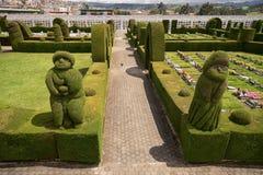 utarbetad topiary i den Tulcan Ecuador kyrkogården Royaltyfri Bild