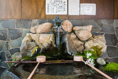 Utasu Jinja Shrine. Kanazawa, Japan - May 4, 2016: Dragon fountain for Ritual Hand Washing at Utasu Jinja Shrine near Higashi Chaya District (East Geisha Stock Photography