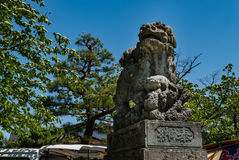 Utasu Jinja Shrine. Kanazawa, Japan - May 4, 2016: Lion statue at Utasu Jinja Shrine near Higashi Chaya District (East Geisha District) in Kanazawa, Ishikawa Stock Photo