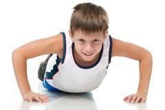Utbildande idrotts- pojke Royaltyfria Bilder