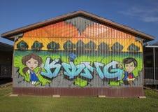 Utbildning är konungen Mural i trädgården av John H Reagan Elementary biskop Arts District, Dallas, Texas royaltyfria bilder