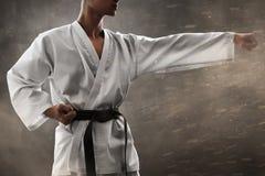 Utbildning för kampsportkämpestansmaskin arkivfoto
