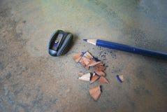 Utbildning tillbehör (blyertspenna, vässaren) Fotografering för Bildbyråer