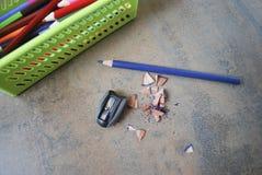 Utbildning tillbehör (blyertspennor, vässaren) Royaltyfria Foton