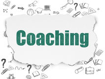 Utbildningsbegrepp: Coachning på sönderrivet papper Royaltyfri Bild
