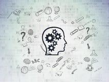 Utbildningsbegrepp: Huvud med kugghjul på digitalt Arkivfoton