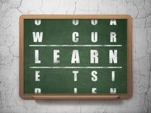 Utbildningsbegrepp: ordet lär, i lösning av korsordet Royaltyfri Fotografi
