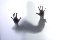 utbredd silhouettekvinna Arkivbilder