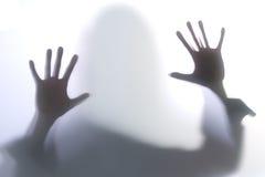 utbredd silhouettekvinna Arkivbild