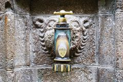 Utdoor medieval water tap in Saint Michael Abbey Royalty Free Stock Photography