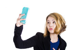 Ute blonde woman taking photo of herself with a smart phone Stock Photography