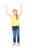 Сute happy girl with raised hands up. Royalty Free Stock Image
