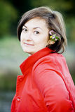 Сute lady in a red jacket Royalty Free Stock Photos
