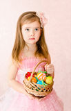 Little girl with basket full of colorful easter eggs Royalty Free Stock Image