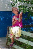 Сute little girl holding a candy Royalty Free Stock Images