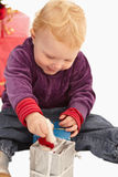 Ute Little girl playing with christmas presents Stock Images