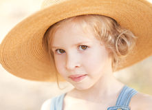 Сute little girl wearing hat outdoors. Closeup portrait of cute little girl wearing hat outdoors Royalty Free Stock Image
