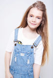 сute teenage girl in jean overall Royalty Free Stock Photo