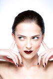 Ute woman closed ears by her hands Stock Images