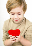 Сute young boy with a red heart Stock Images