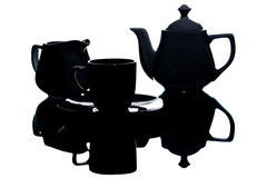 Utensílios brancos do chá na máscara em um fundo branco Imagens de Stock