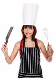 Utensílios Brandishing de sorriso do cozinheiro chefe fotos de stock
