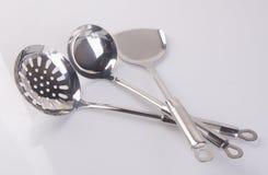 utensílios da cozinha ou utensílios de alta qualidade da cozinha no fundo Fotografia de Stock Royalty Free