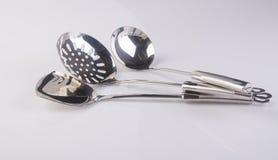 utensílios da cozinha ou utensílios de alta qualidade da cozinha no fundo Imagem de Stock Royalty Free