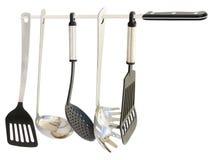 Utensílios da cozinha que penduram de uma faca Fotografia de Stock Royalty Free