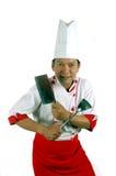 Utensílios de cozimento da terra arrendada do cozinheiro chefe e faca de cozinha Fotografia de Stock