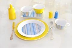 Utensílios de mesa amarelos Imagem de Stock Royalty Free
