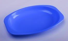 Utensílios de mesa plásticos azuis imagem de stock royalty free