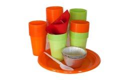 Utensílios de mesa plásticos brilhantes isolados no branco Imagens de Stock