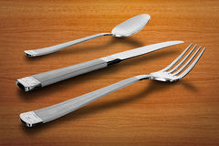 Utensil. Kitchen utensil. spoon and knife with fork over table Stock Photos