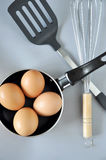 Utensil with Eggs in Pan Stock Photography