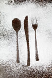 Utensil silhouette in sugar dust stock images