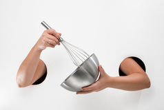 Utensil. A whisk and mixing bowl. Stock Photos