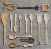 Utensil. Wooden kitchen utensil on Sackcloth background Stock Image