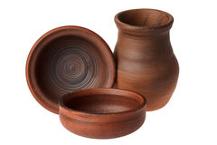 Utensili ceramici su un fondo bianco Fotografia Stock