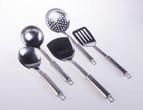 Utensili della cucina utensilson della cucina su un fondo Immagine Stock