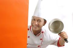 Utensili di cottura della holding del cuoco unico Immagine Stock Libera da Diritti