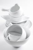 Utensilios blancos de la loza y de la cocina Fotografía de archivo