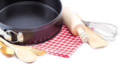 Utensilios de cocinar para cocer en un fondo blanco Imágenes de archivo libres de regalías
