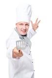 Utensilios de la cocina del cocinero que agitan feliz activo en un blanco Imágenes de archivo libres de regalías