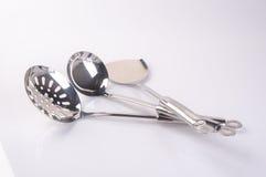 utensilios de la cocina o utensilios de alta calidad de la cocina en fondo Imágenes de archivo libres de regalías