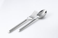 Utensils. A picture of a pair of fork and spoon Stock Photos