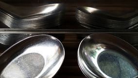 Utensils. Bronze utensils and reflection of spoons Royalty Free Stock Image