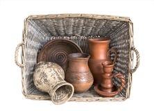 Utensils. clay. Ware from clay. basket of vines. retro. utensils village. handwork Stock Photography